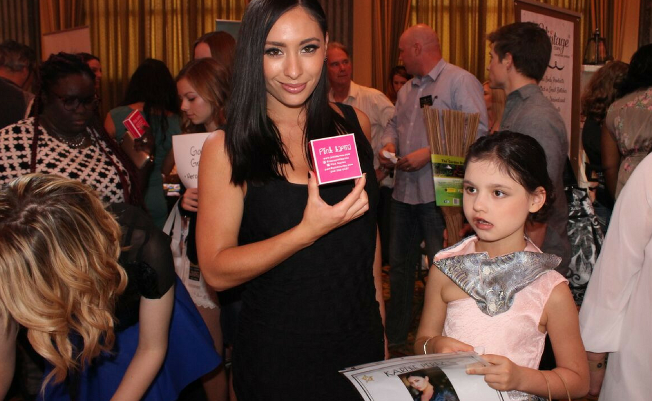 Karlee Perez, also known as Maxine from WWE, strikes a pose with her new Pink Karma exclusive Mermaid Necklace from The Oscars in 2016. Pink Karma debuted their new line at Celebrity Connected's Luxury Oscar Gifting Suite in 2016.